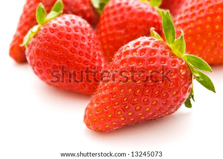 fresh strawberries with shallow depth of field on white background