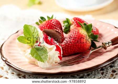 Fresh strawberries with whipped cream and chocolate