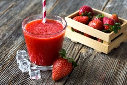 Fresh strawberry drink on wood background