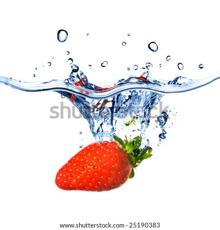 Fresh strawberry dropped into blue water with splash isolated on white