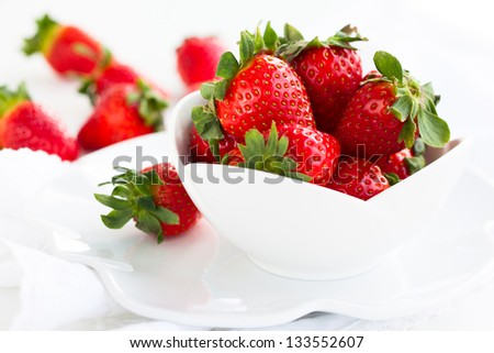 Fresh strawberry in the white bowl