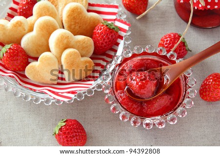 Fresh strawberry jam with heart shaped toast