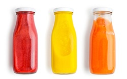 Fresh strawberry, mango and papaya smoothies in bottles isolated on white  background, top view.