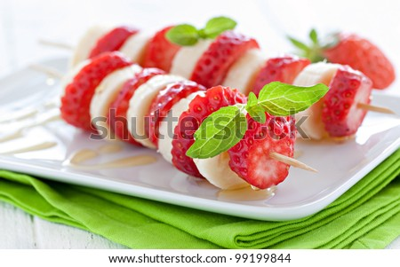 fresh strawberry skewers with banana and honey