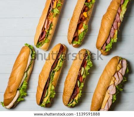 Fresh sub sandwich on white and wheat hoagies. #1139591888