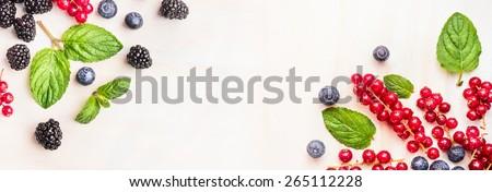 Fresh summer berries, corner frames on white wooden background, top view, banner for website #265112228