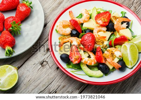Fresh summer salad with prawn,strawberry,avocado,lime and olive.Summer salad,healthy eating