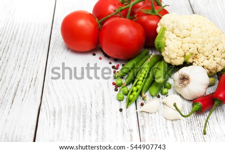 Fresh summer vegetables on a old wooden table #544907743