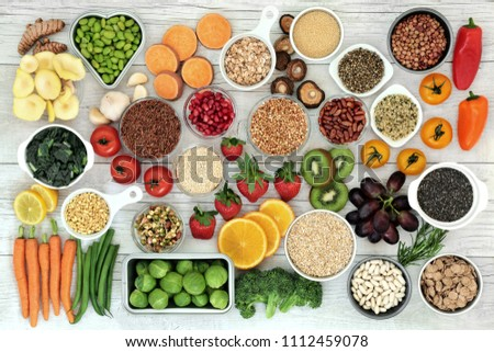 Fresh super food concept with fruit, vegetables, grains, cereals, pulses, seeds, herbs and spice. Foods high in fibre, anthocyanins, antioxidants, smart carbohydrates, minerals and vitamins. #1112459078