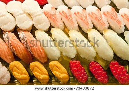 fresh sushi platter with a lot of variety