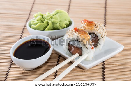 Fresh Sushi Rolls on a small plate with Soy Sauce and Wasabi