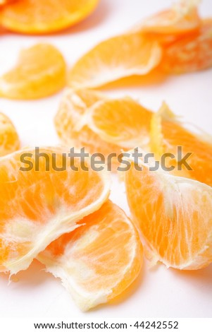 fresh sweet mandarin wedges on white background