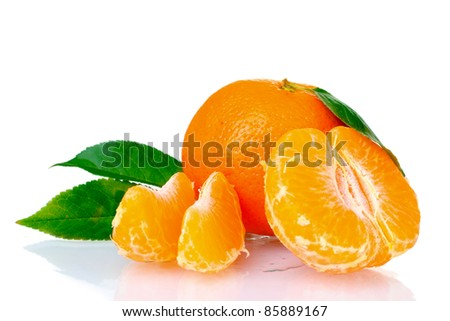 Fresh tangerine with leaves and cloves isolated on white