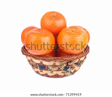 Fresh tangerines in a basket isolated  on white background