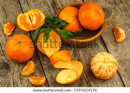 Fresh tangerines on old wooden board. Healthy exotic fruits. Diet food. Tangerine on the table. #1395024596