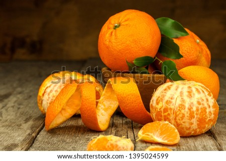 Fresh tangerines on old wooden board. Healthy exotic fruits. Diet food. Tangerine on the table. #1395024599