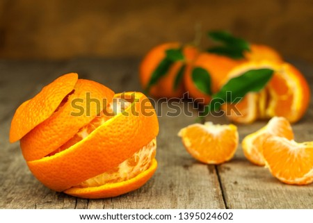 Fresh tangerines on old wooden board. Healthy exotic fruits. Diet food. Tangerine on the table. #1395024602