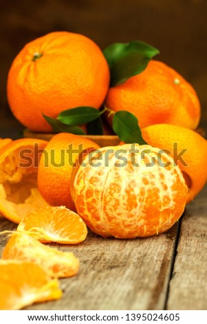 Fresh tangerines on old wooden board. Healthy exotic fruits. Diet food. Tangerine on the table. #1395024605