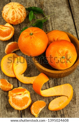 Fresh tangerines on old wooden board. Healthy exotic fruits. Diet food. Tangerine on the table. #1395024608