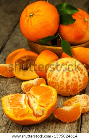 Fresh tangerines on old wooden board. Healthy exotic fruits. Diet food. Tangerine on the table. #1395024614