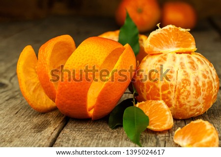 Fresh tangerines on old wooden board. Healthy exotic fruits. Diet food. Tangerine on the table. #1395024617