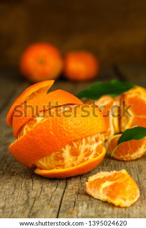 Fresh tangerines on old wooden board. Healthy exotic fruits. Diet food. Tangerine on the table. #1395024620