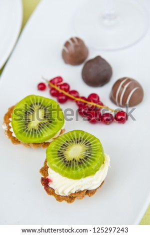 fresh tarts with cream and fruits