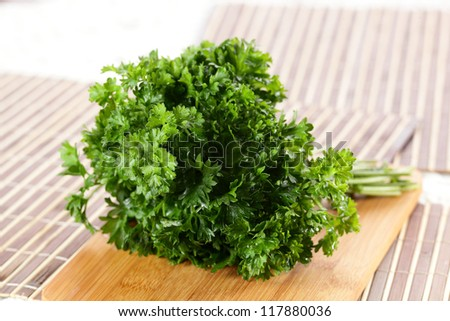fresh tasty and wet salad on wooden background