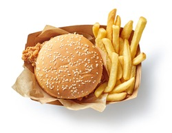 fresh tasty burger and french fries in paper box isolated on white background, top view