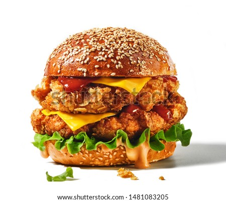 Fresh tasty burger isolated on white background. Big double cheddar cheeseburger with chicken cutlet
