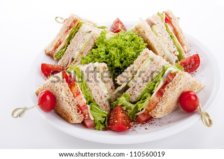 fresh tasty club sandwich with lettuce cheese ham and toast isolated on white background