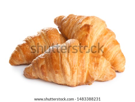 Fresh tasty croissants on white background. French pastry