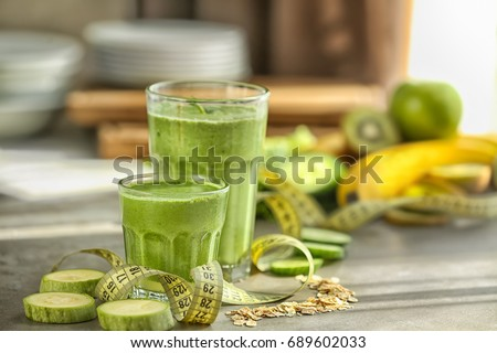 Fresh tasty smoothies in glasses on table