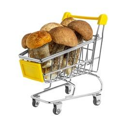 Fresh tasty wild mushrooms in the shopping cart. Organic orange-cap boletus. Creative vegan food concept. Isolated on white. Clipping path.