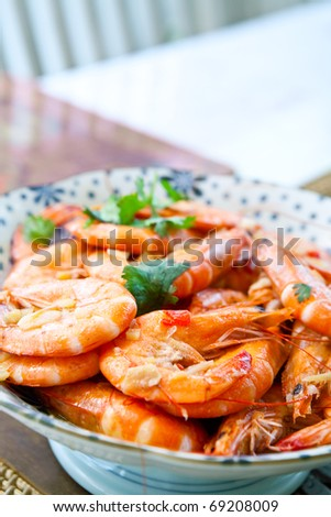 Fresh tiger prawns in garlic and chili with coriander