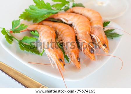 Fresh tiger shrimps on a small plate