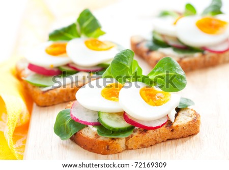 Fresh toast sandwiches with egg,radish,cucumber and soft cheese
