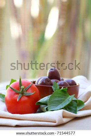 Fresh Tomato, Basil and Black Olives in the garden (Food from the Mediterranean)