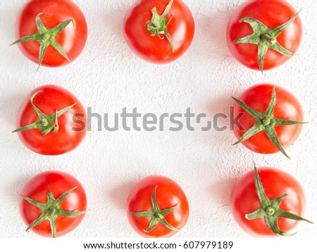 Fresh tomato juicy on a branch close-up on a light background horizontal view top view #607979189