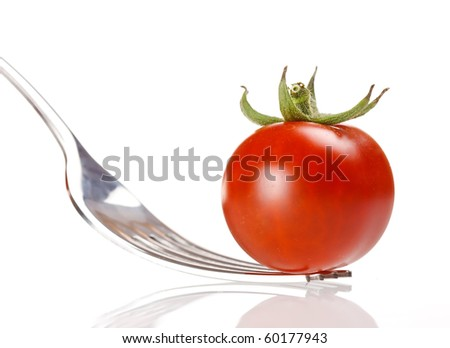 fresh tomato on the fork