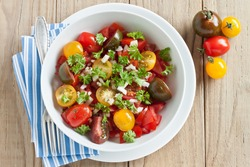 Fresh tomato salad with onion and parsley