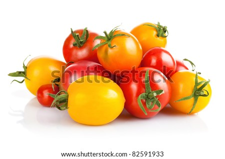 fresh tomato vegetables with green leaves isolated on white background