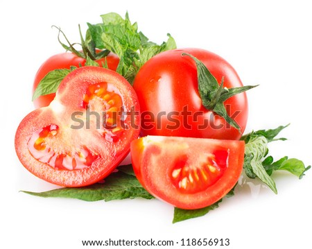 fresh tomato with leaves isolated on white background