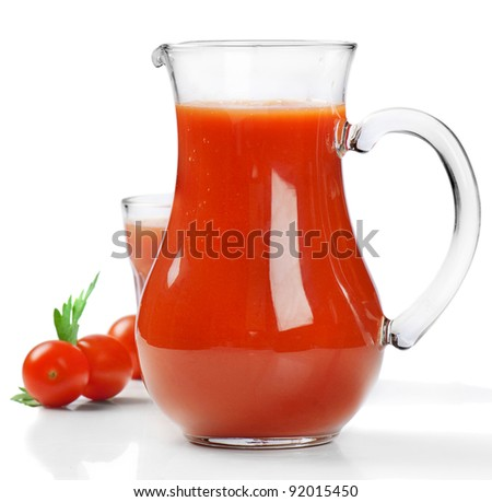 Fresh tomatoes and juice isolated on white