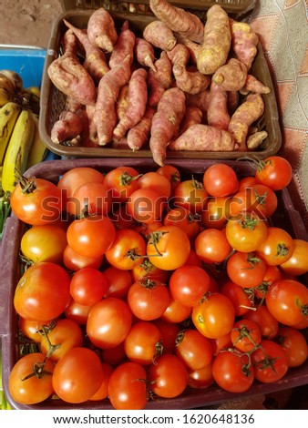 Fresh tomatoes, fresh sweet potato tubers