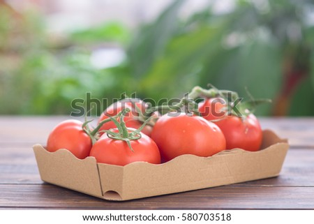 Fresh tomatoes in a package #580703518