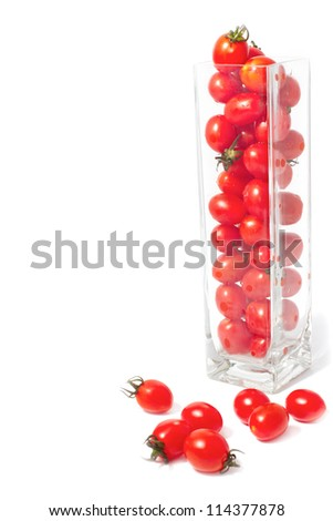 fresh tomatoes in  glass box on white background