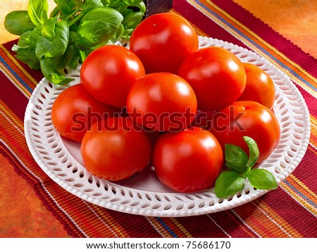 Fresh tomatoes on a plate