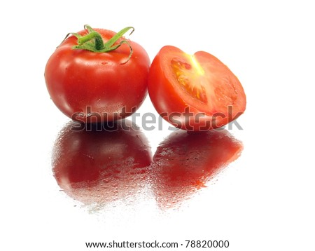 fresh tomatoes on a white background with water drops