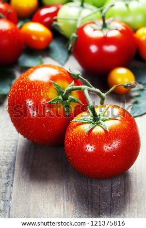 Fresh tomatoes on a wooden table top